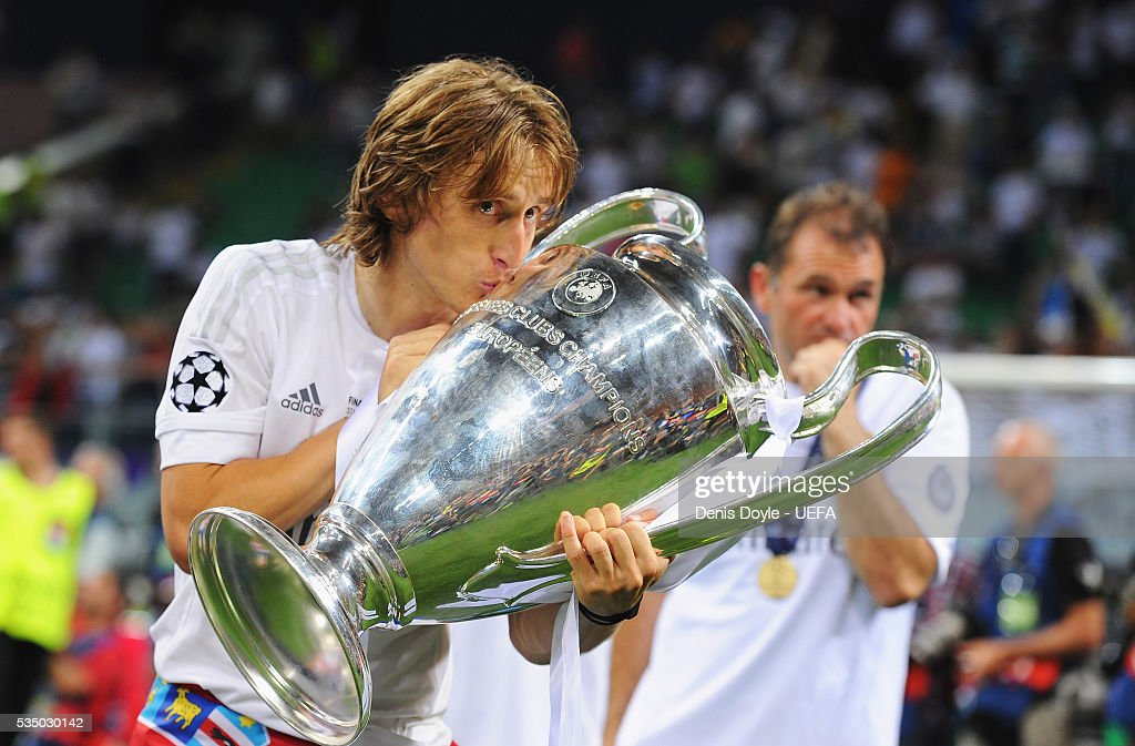 Luka Modric of Real Madrid kisses the trophy after the UEFA Champions League Final between Real Madrid and Club Atletico de Madrid at Stadio Giuseppe Meazza on May 28, 2016 in Milan, Italy.