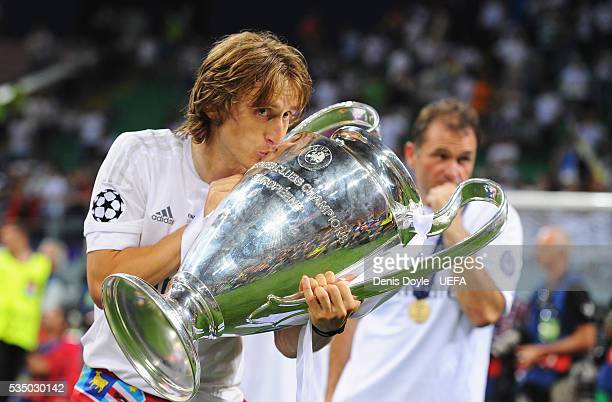 Luka Modric of Real Madrid kisses the trophy after the UEFA Champions League Final between Real Madrid and Club Atletico de Madrid at Stadio Giuseppe...