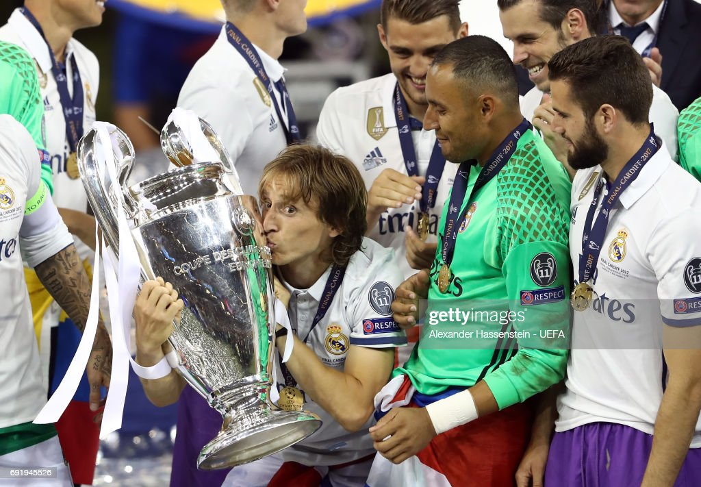Luka Modric of Real Madrid kisses the trophy after the UEFA Champions League Final between Juventus and Real Madrid at National Stadium of Wales on June 3, 2017 in Cardiff, Wales.