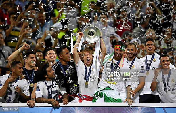Luka Modric of Real Madrid lifts the Champions League trophy after the UEFA Champions League Final match between Real Madrid and Club Atletico de...