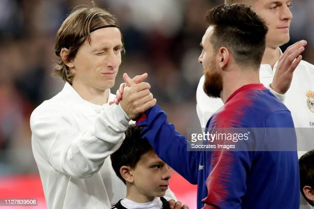 Luka Modric of Real Madrid Lionel Messi of FC Barcelona during the Spanish Copa del Rey match between Real Madrid v FC Barcelona at the Santiago...