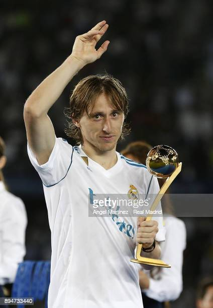 Luka Modric of Real Madrid poses with adidas Golden Ball trophy after the FIFA Club World Cup UAE 2017 Final match between Real Madrid CF and Gremio...