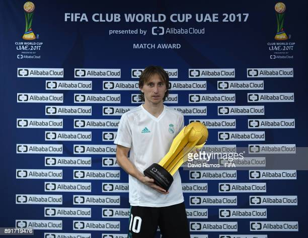 Luka Modric of Real Madrid poses with his man of the match trophy after the FIFA Club World Cup UAE 2017 semifinal match between Al Jazira and Real...