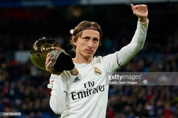 Luka Modric of Real Madrid presents his Ballon d'Or Trophy prior to the La Liga match between Real Madrid CF and Rayo Vallecano de Madrid at Estadio...