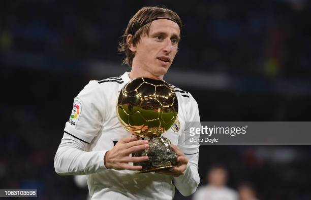 Luka Modric of Real Madrid presents his Balon d'Or Trophy to the crown prior to the La Liga match between Real Madrid CF and Rayo Vallecano de Madrid...