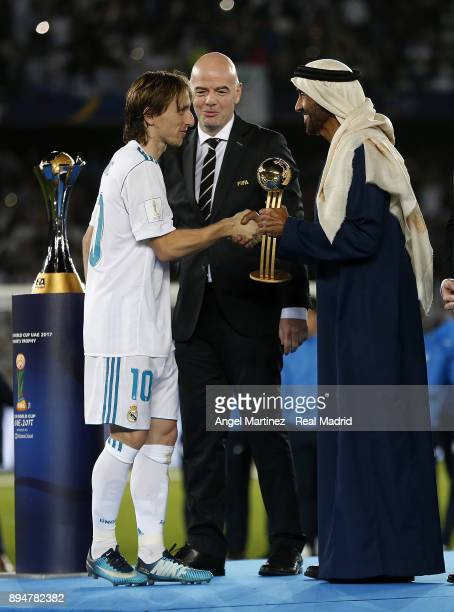 Luka Modric of Real Madrid receives the adidas Golden Ball trophy after the FIFA Club World Cup UAE 2017 Final match between Real Madrid CF and...