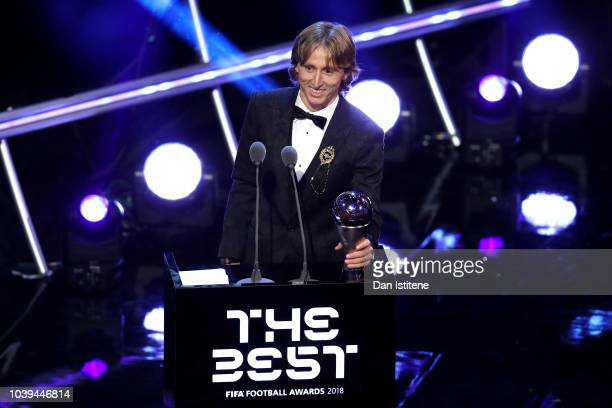 Luka Modric of Real Madrid receives the trophy for The Best FIFA Men's Player 2018 during the The Best FIFA Football Awards Show at Royal Festival...