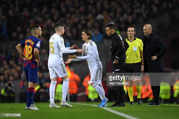 Luka Modric of Real Madrid replaces Federico Valverde of Real Madrid during the Liga match between FC Barcelona and Real Madrid CF at Camp Nou on...
