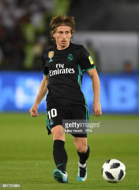 Luka Modric of Real Madrid runs with the ball during the FIFA Club World Cup UAE 2017 semifinal match between Al Jazira and Real Madrid on December...