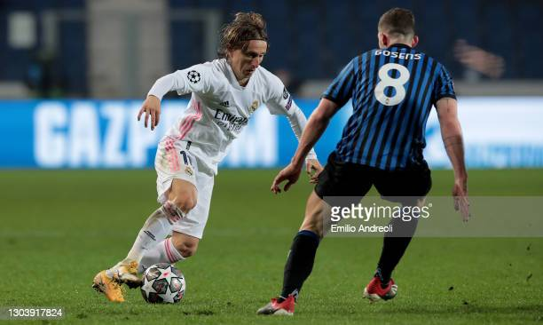 Luka Modric of Real Madrid runs with the ball whilst under pressure from Robin Gosens of Atalanta B.C. During the UEFA Champions League Round of 16...