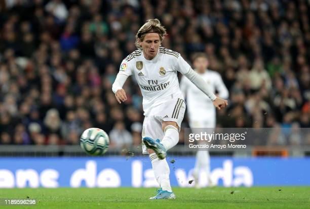 Luka Modric of Real Madrid scores his team's third goal during the La Liga match between Real Madrid CF and Real Sociedad at Estadio Santiago...