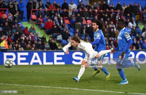 Luka Modric of Real Madrid scores his team's third goal during the La Liga match between Getafe CF and Real Madrid CF at Coliseum Alfonso Perez on...