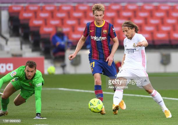 Luka Modric of Real Madrid scores his team's third goal during the La Liga Santander match between FC Barcelona and Real Madrid at Camp Nou on...