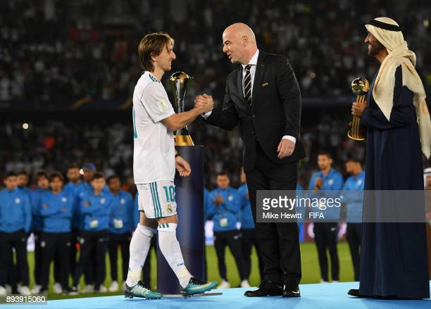 Luka Modric of Real Madrid shakes hands with Gianni Infantino after the FIFA Club World Cup UAE 2017 Final between Gremio and Real Madrid at the...