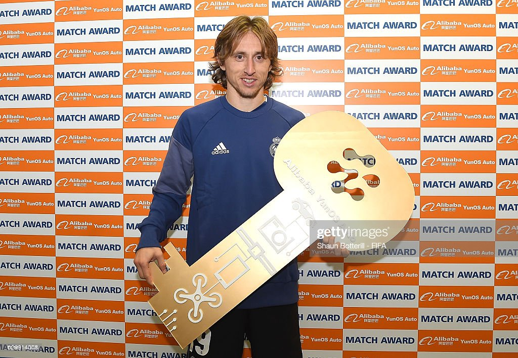 Luka Modric of Real Madrid stands with the man of the match award during the FIFA Club World Cup Semi Final match between Club America and Real Madrid at International Stadium Yokohama on December 15, 2016 in Yokohama, Japan.