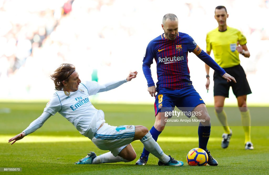 https://media.gettyimages.com/photos/luka-modric-of-real-madrid-tackles-andres-iniesta-of-barcelona-during-picture-id897553570?k=6&m=897553570&s=594x594&w=0&h=KICHAwio5NjdSW70Cen1mqjsRLAhxd45bzWZGb5NzUU=