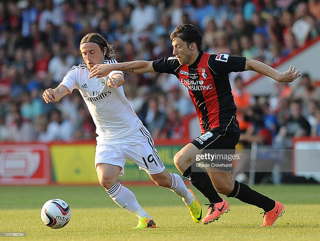 Luka Modric of Real Madrid tries to hold of Harry Arter of Bournemouth during the pre season friendly match between Bournemouth and Real Madrid at Goldsands Stadium on July 21, 2013 in Bournemouth, England,