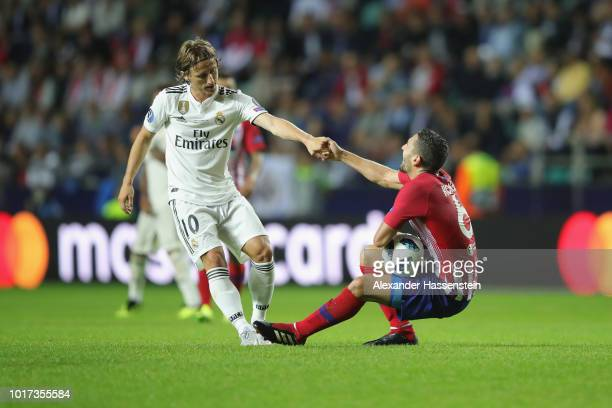 Luka Modric of Real reacts with Koke of Atletico during the UEFA Super Cup between Real Madrid and Atletico Madrid at Lillekula Stadium on August 15...