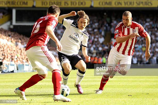 Luka Modric of Spurs is closed down by Salif Diao and Jonathan Walters of Stoke during the Barclays Premier League match between Tottenham Hotspur...