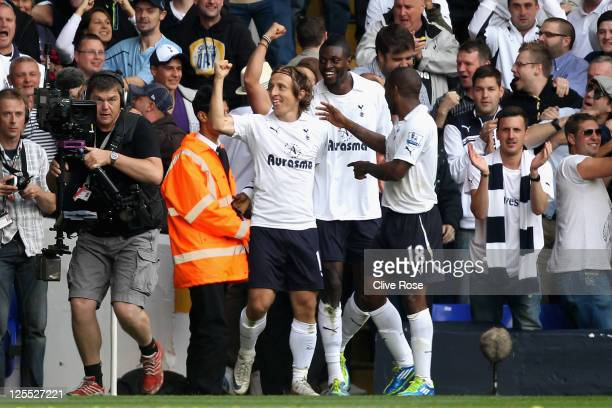 Luka Modric of Tottenham Hotspur celebrates scoring the opening goal with teammates Emmanuel Adebayor and Jermain Defoe during the Barclays Premier...