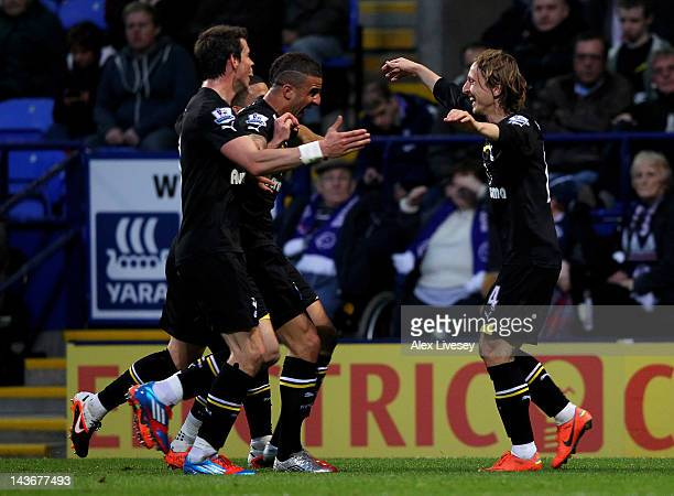 Luka Modric of Tottenham Hotspur celebrates with his team mates after scoring the opening goal during the Barclays Premier League match between...