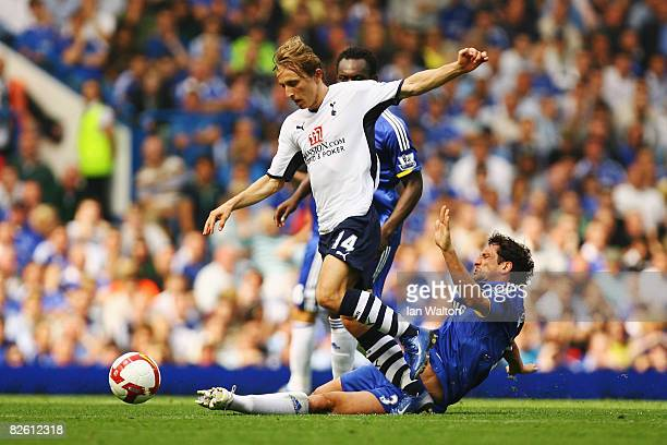 Luka Modric of Tottenham Hotspur holds off the challenge of Juliano Belletti of Chelsea during the Barclays Premier League match between Chelsea and...