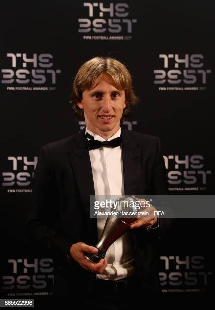 Luka Modric poses with his award after being included in the team of the year after The Best FIFA Football Awards at The London Palladium on October...