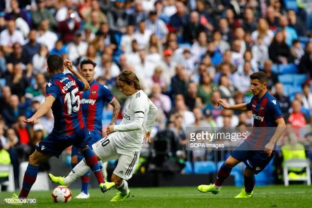 Luka Modric seen in action during the La Liga match between Real Madrid and Levante UD at Estadio Santiago Bernabéu. .