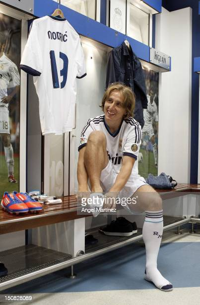Luka Modric the new signing for Real Madrid dresses in locker room before his official presentation at Santiago Bernabeu stadium on August 27 2012 in...