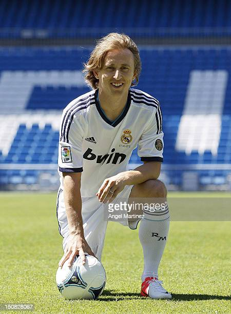 Luka Modric the new signing for Real Madrid poses during his official presentation at Santiago Bernabeu stadium on August 27 2012 in Madrid Spain