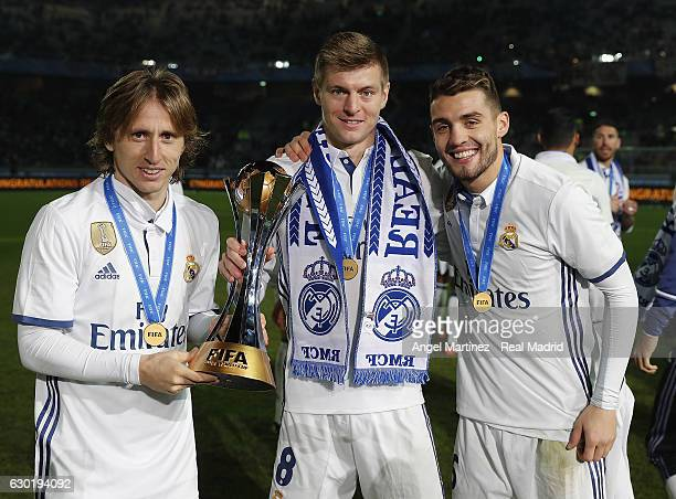 Luka Modric Toni Kroos and Mateo Kovacic of Real Madrid pose with the trophy after the FIFA Club World Cup Final match between Real Madrid and...