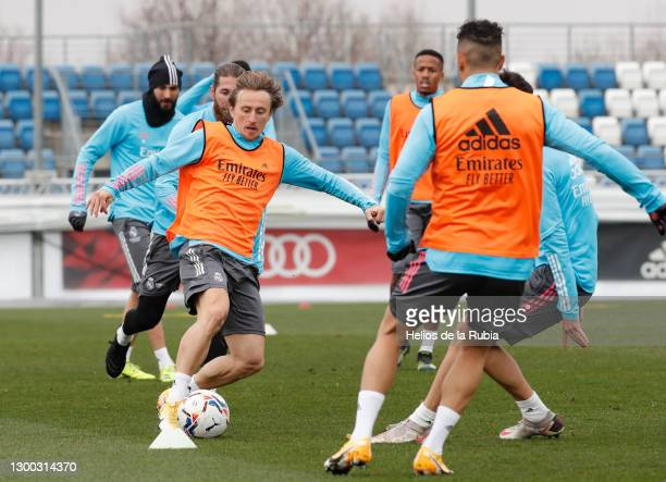 Luka Modric with Mariano Díaz of Real Madrid during a training session at Valdebebas training ground on February 04, 2021 in Madrid, Spain.