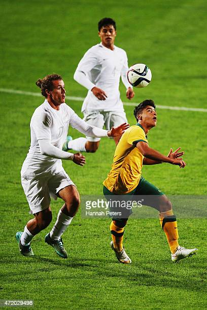 Luka Prelevic of New Zealand defends against Daniel Arzani of Australia during the U20 Five Nations match between New Zealand and Australia at QBE...