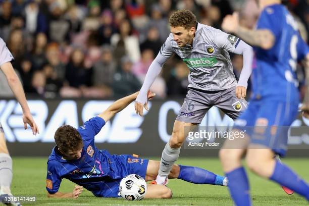 Luka Prso of the Jets is contested by Gianni Stensness of the Mariners during the A-League match between Newcastle Jets and Central Coast Mariners at...