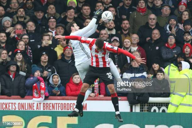 Luka Racic of Brentford challenging Danny Ward of Leicester City for the ball during the FA Cup match between Brentford and Leicester City at Griffin...