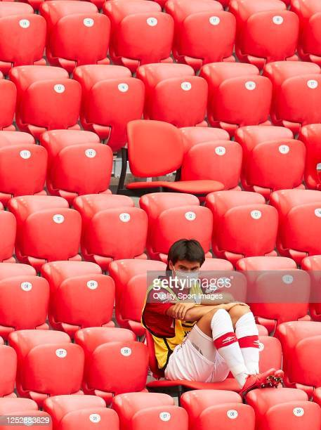 Luka Romero of RCD Mallorca wearing a face mask sits in grandstand as he attends the Liga match between Athletic Club and RCD Mallorca at San Mames...