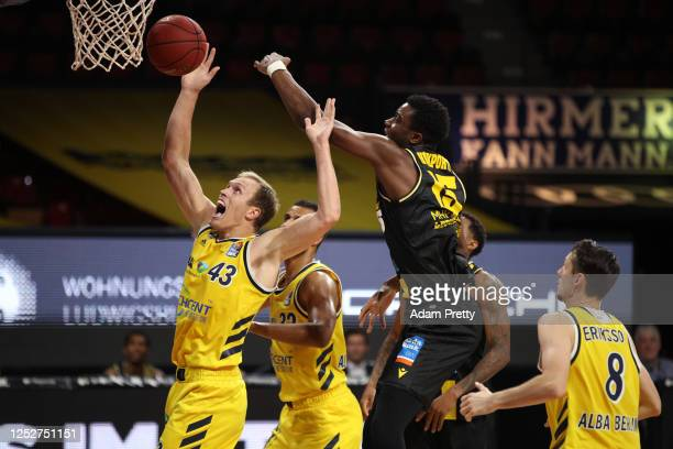 Luka Sikma of Berlin and Ariel Hukporti of Ludwigsburg jump for a rebound during the EasyCredit Basketball Bundesliga final first leg match between...