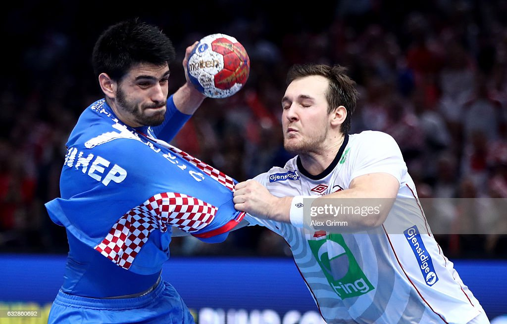 Luka Stepancic (L) of Croatia challenges Christian O'Sullivan of Norway during the 25th IHF Men's World Championship 2017 Semi Final match between Croatia and Norway at Accorhotels Arena on January 27, 2017 in Paris, France.