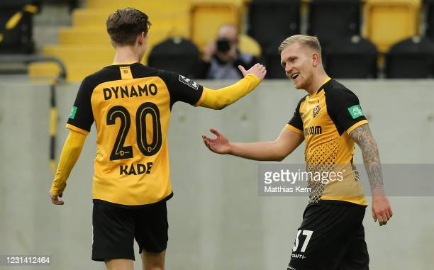 Luka Stor of Dresden celebrates with teammate Julius Kade after scoring his team's fourth goal during the 3. Liga match between Dynamo Dresden and FC...