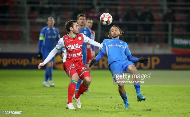 Luka Zarandia of Zulte battles for the ball with Theo Bongonda of Krc Genk during the Jupiler Pro League match between SV Zulte Waregem and KRC Genk...