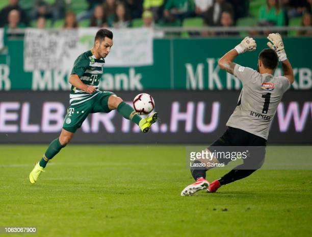 Lukacs Bole of Ferencvarosi TC scores before goalkeeper Artem Kychak of MTK Budapest during the Hungarian OTP Bank Liga match between Ferencvarosi TC...