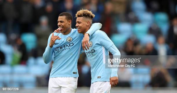 Lukas and Felix Nmecha of Manchester City celebrate after winning the UEFA Youth League QuarterFinal at Manchester City Football Academy on March 14...