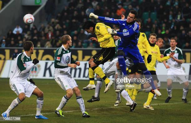 Lukas Barrios of Dortmund and Diego Benaglio of Wolfsburg battle for the ball during the Bundesliga match between VfL Wolfsburg and Borussia Dortmund...