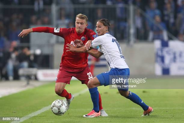 Lukas Boeder of Paderborn and Tobias Schwede of Magdeburg compete during the 3 Liga match between 1 FC Magdeburg and SC Paderborn 07 at MDCCArena on...