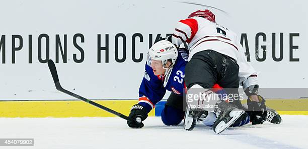 Lukas Cingel of Sparta Prague hits Gustav Rydahl of Växjö Lakers during the Champions Hockey League group stage game between Vaxjo Lakers and Sparta...