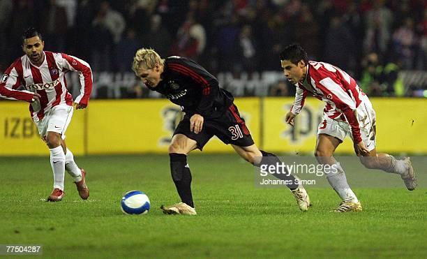Lukas da Silva and Djordje Tutoric of Belgrade and Bastian Schweinsteiger of Bayern action during the UEFA Cup group F match between Crvena Zvezda...