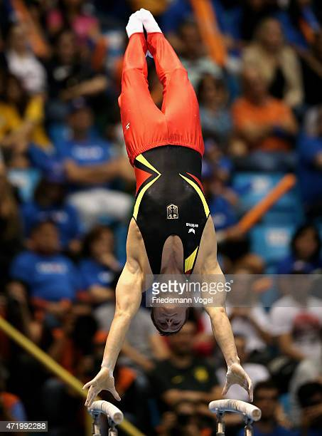 Lukas Dauser of Germany competes on the Parallel Bars during day one of the Gymnastics World Challenge Cup Brazil 2015 at Ibirapuera Gymnasium on May...