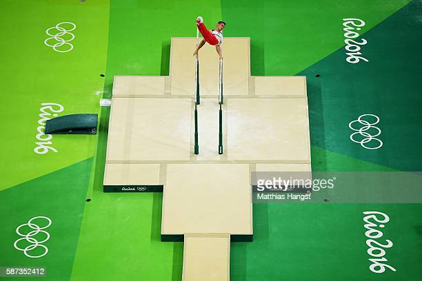 Lukas Dauser of Germany competes on the parallel bars during the men's team final on Day 3 of the Rio 2016 Olympic Games at the Rio Olympic Arena on...