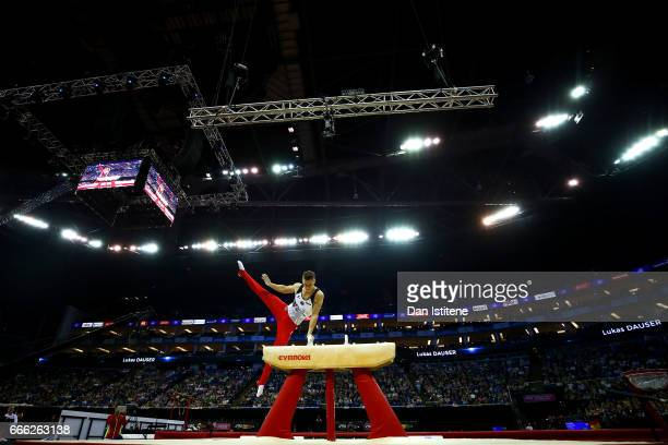 Lukas Dauser of Germany competes on the pommel horse during the men's competition for the iPro Sport World Cup of Gymnastics at The O2 Arena on April...