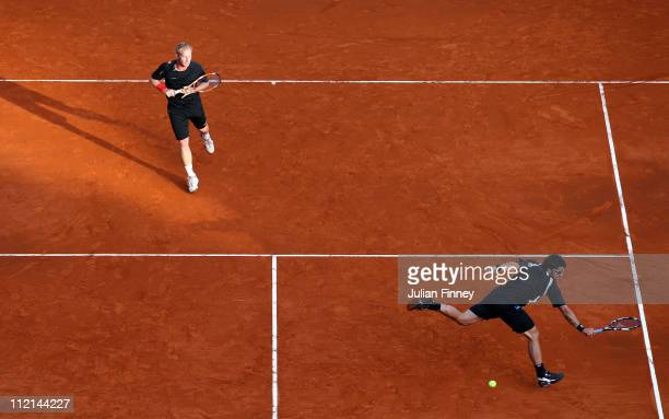 Lukas Dlouhy of Czech Republic and Janko Tipsarevic of Serbia in action against Gael Monfils of France with partner JoWilfried Tsonga of France in...